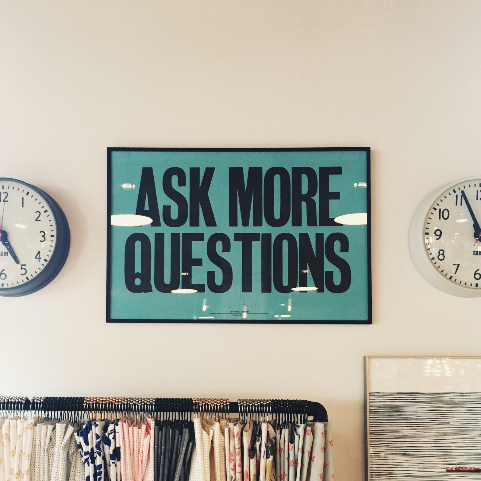 "Blue green ""Ask more questions"" framed poster"