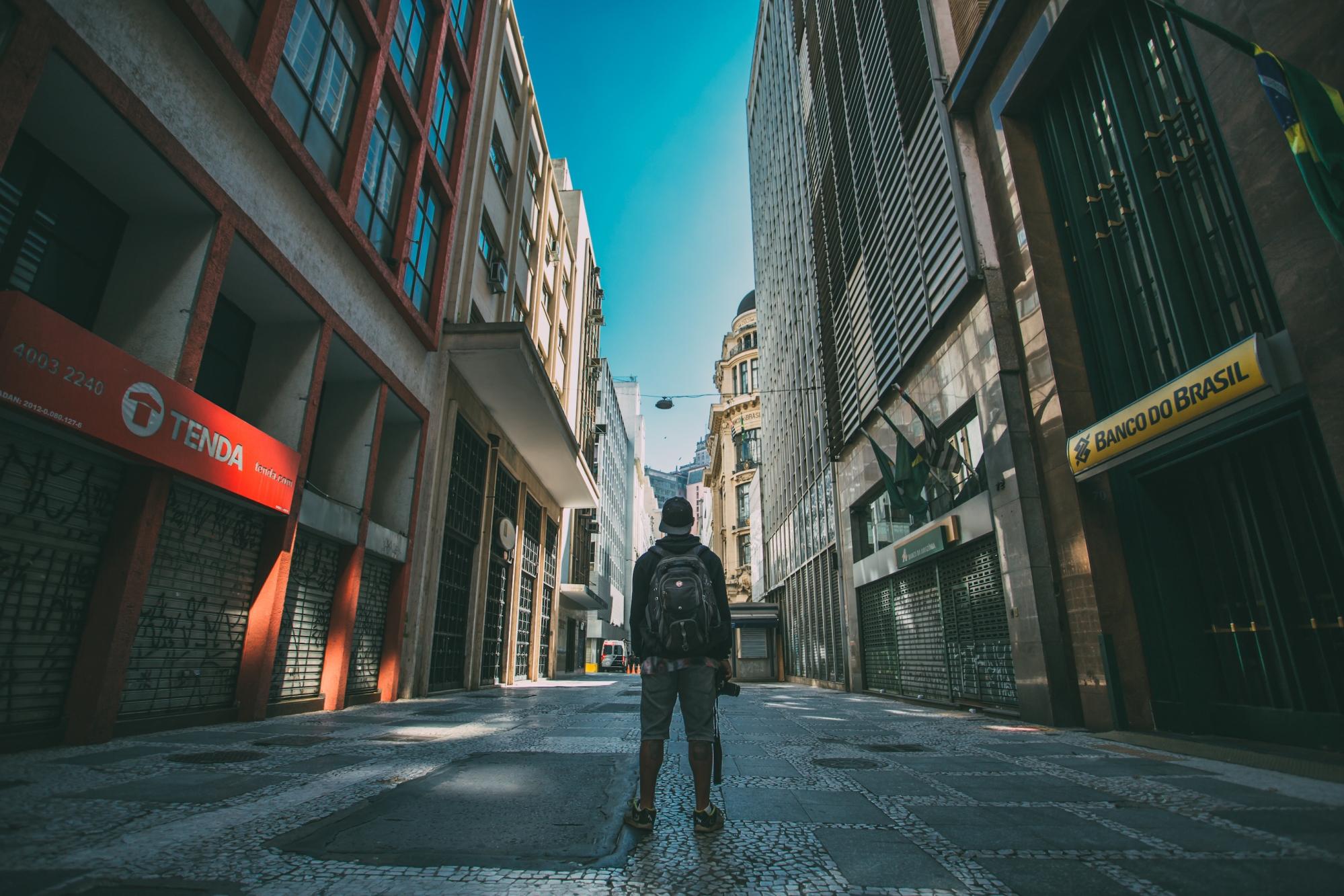 Man facing away standing on a Brazilian street