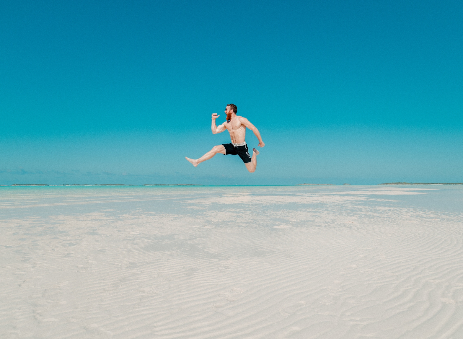 Person jumping on the beach