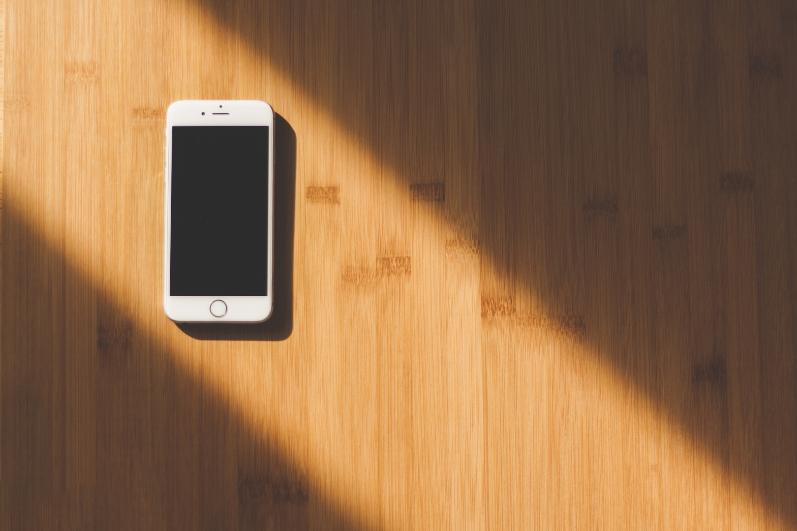 iPhone on a wood table