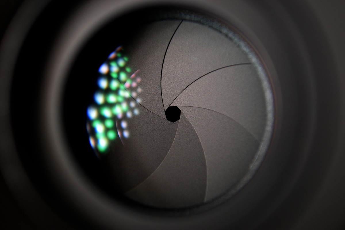 Camera aperture with a green-blue lens flare