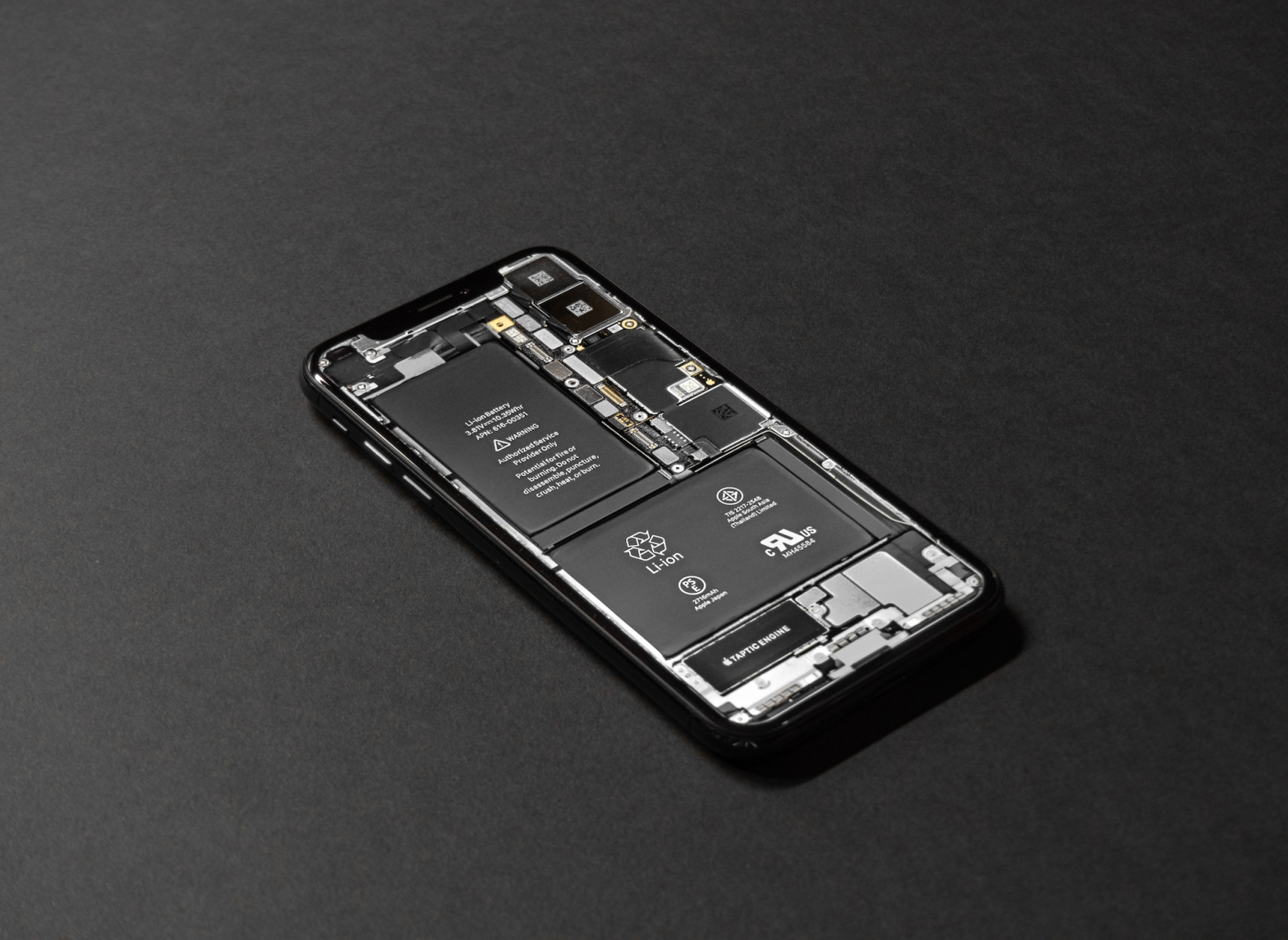 iPhone X innards with batteries showing