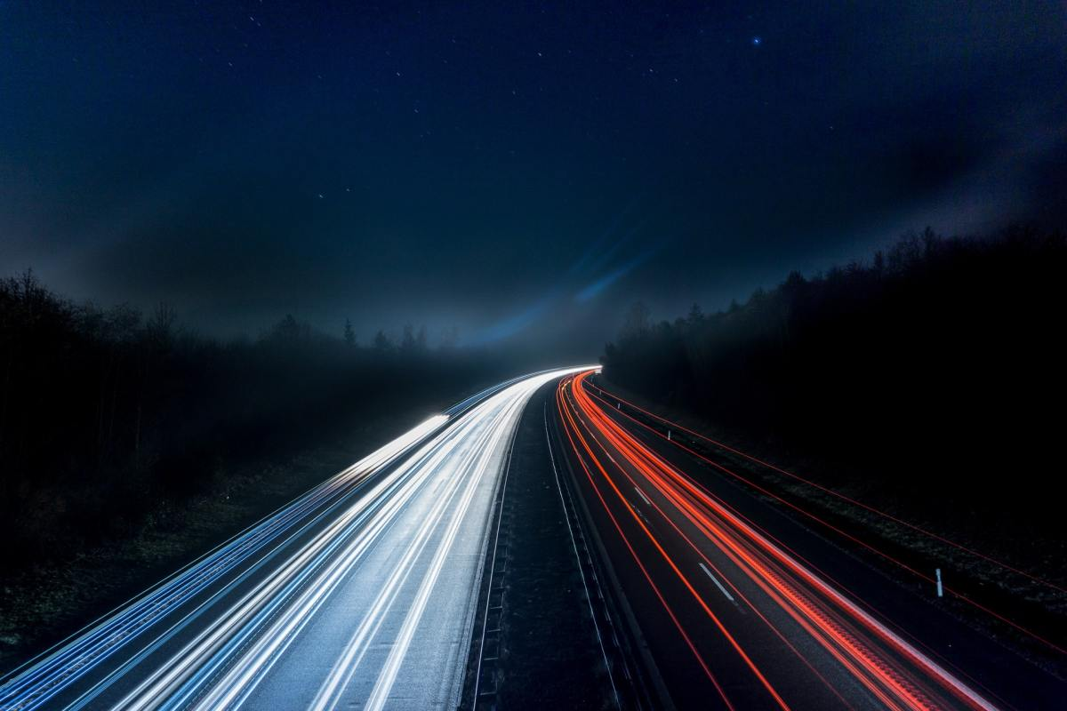 Long exposure photo of car lights on a highway at night